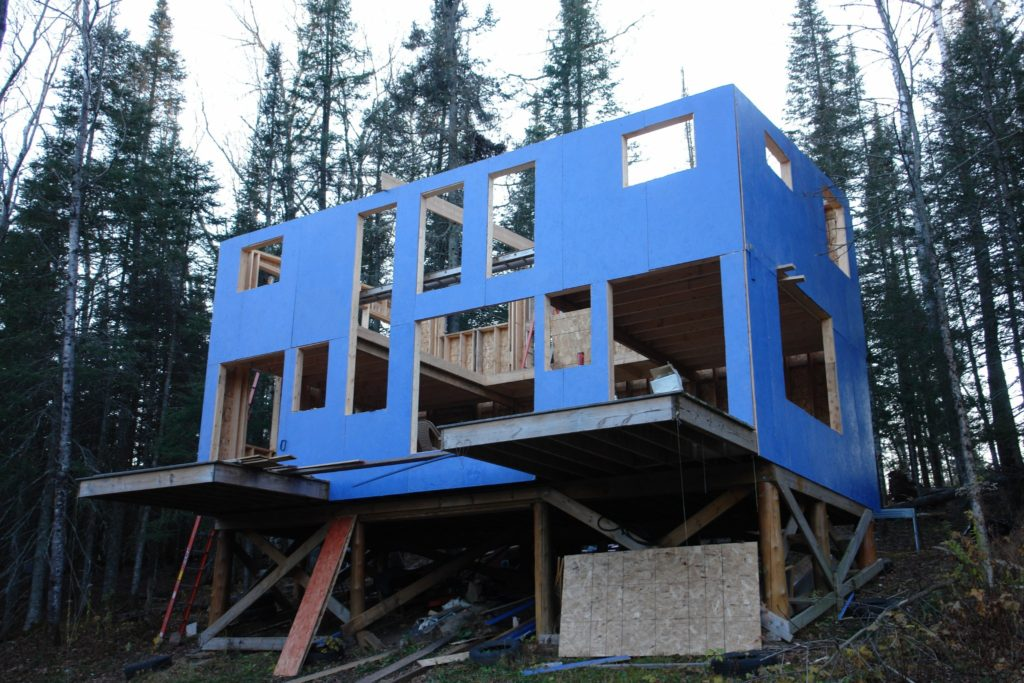 Blue House Construction framing blue