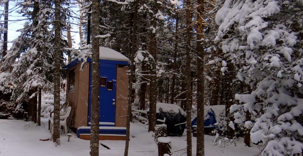 Blue House outside outhouse